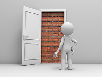 Guy opening a door to a brick wall
