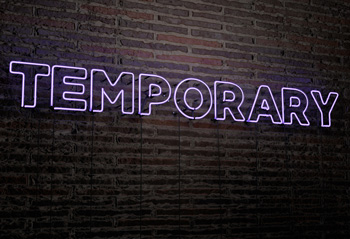 Neon sign showing Temporary
